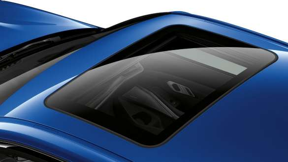 View of the BMW 3 Series Sedan from above with a view of the closed glass roof.