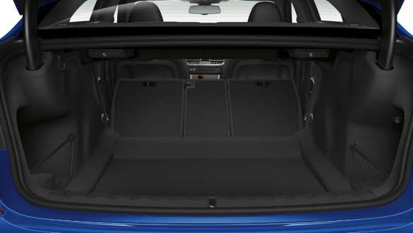 Close-up of the opened trunk with the rear backseats half folded down.