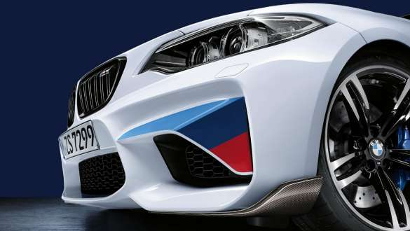 Lateral close-up of the front of the BMW 3 Series Sedan with focus on the BMW M Performance front splitter carbon fibre.