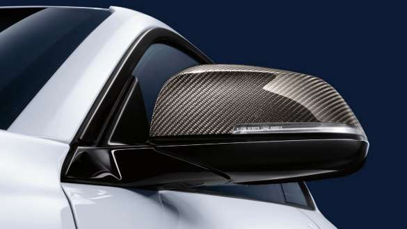 Close-up view of the BMW 3 Series Sedan with focus on the BMW M Performance exterior mirror caps carbon fibre.