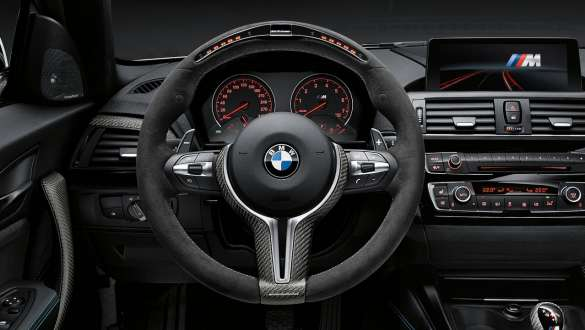 Close-up view of the BMW 3 Series Sedan with focus on the BMW M Performance Parts steering wheel II Alcantara with carbon fibre trim.