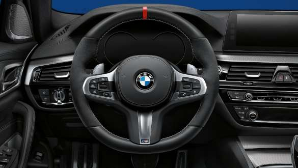 Close-up view of the BMW 3 Series Sedan with focus on the BMW M Performance steering wheel.