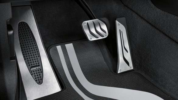 Close-up view of the BMW 3 Series Sedan with focus on the BMW M Performance pedal covers.