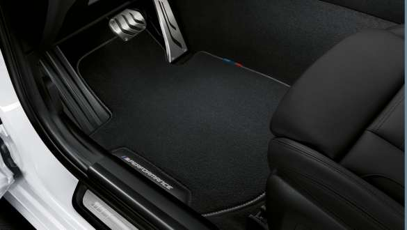 Close-up view of the BMW 3 Series Sedan with focus on the BMW M Performance floor mats.